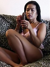 Oriental milf ex girlfriend Tia entertains herself by playing with her sex toy in this hot solo
