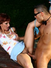 Explicit webcam show with a redhead mature named Myra Cave fucking a bartender outdoors