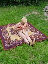 Big boobed and chubby grandma spread legged outdoors and cramming a dildo inside her cunt