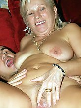 Explicit live cam show with cute and chubby grandma named Remy boning a younger guy on the couch